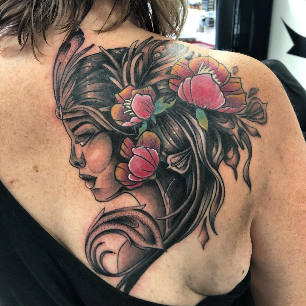Beautiful tattoo of a lady on the shoulder, by Loz